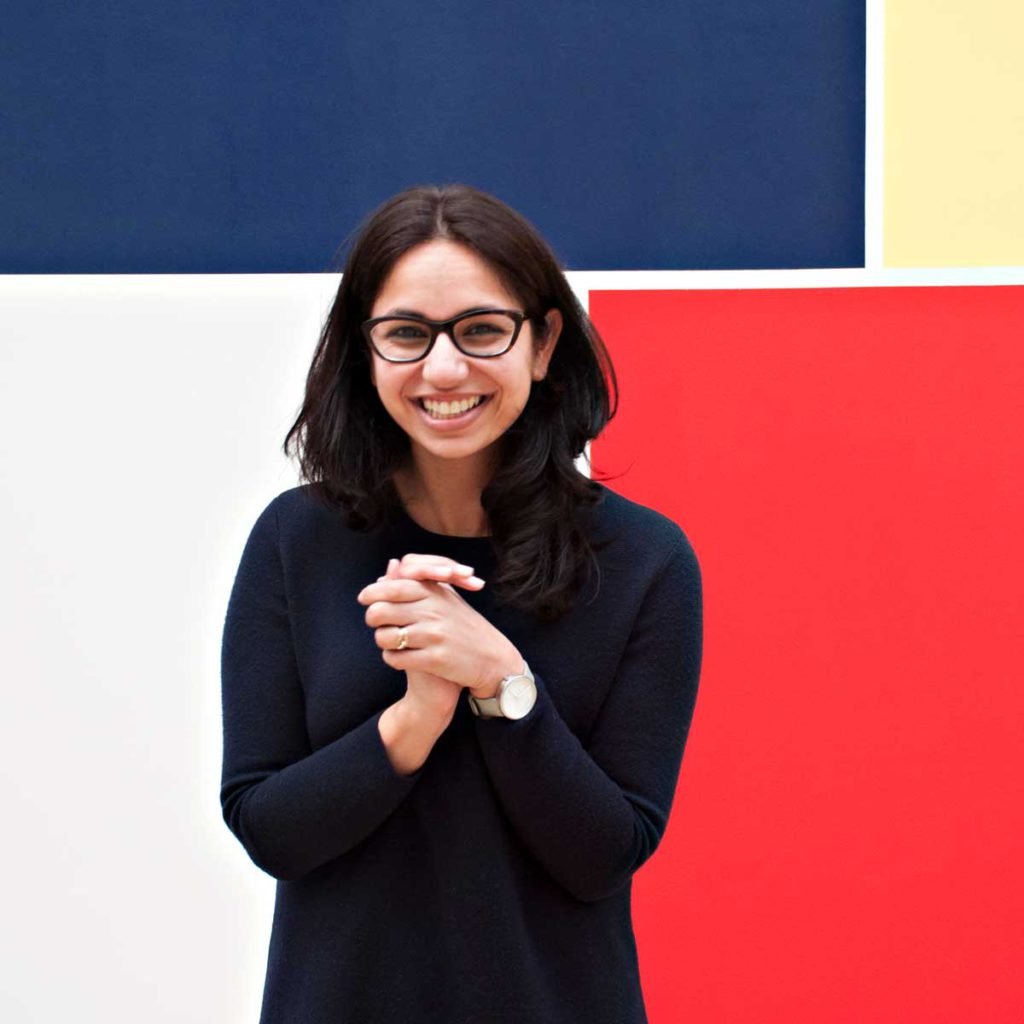 Kangan Arora standing in front of one of her pieces.