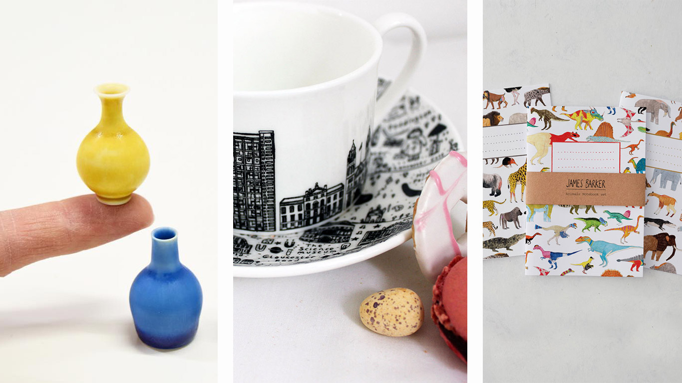 Left: Mini ceramic pots. Middle: Ceramic tea cup with London landmark design. Right: Three notepads with dinosaur designs.