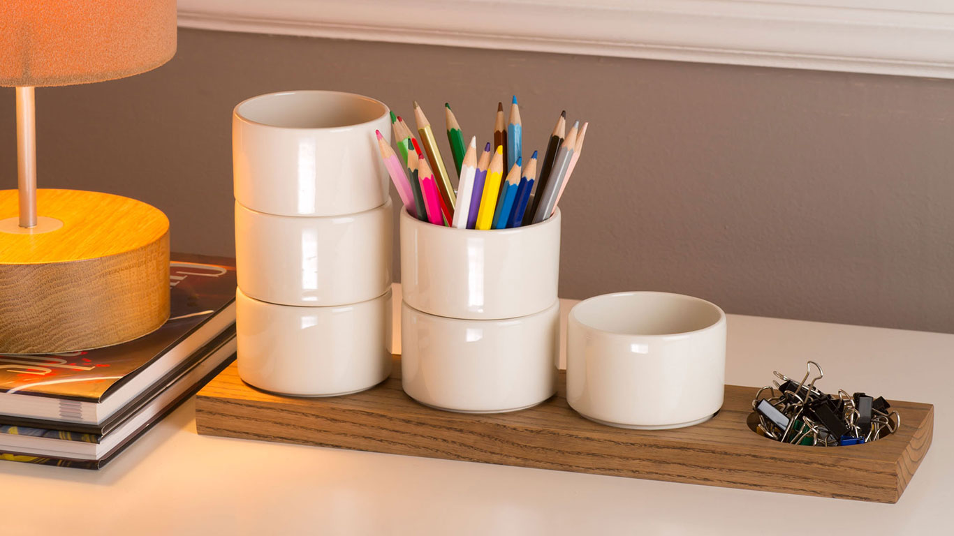 Six ceramic cups with coloured pencils