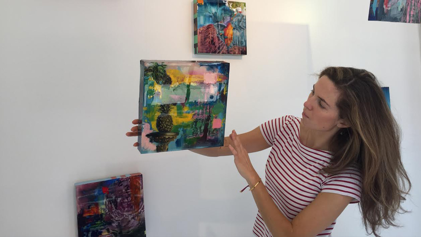 Irina Starkova holding one of her paintings