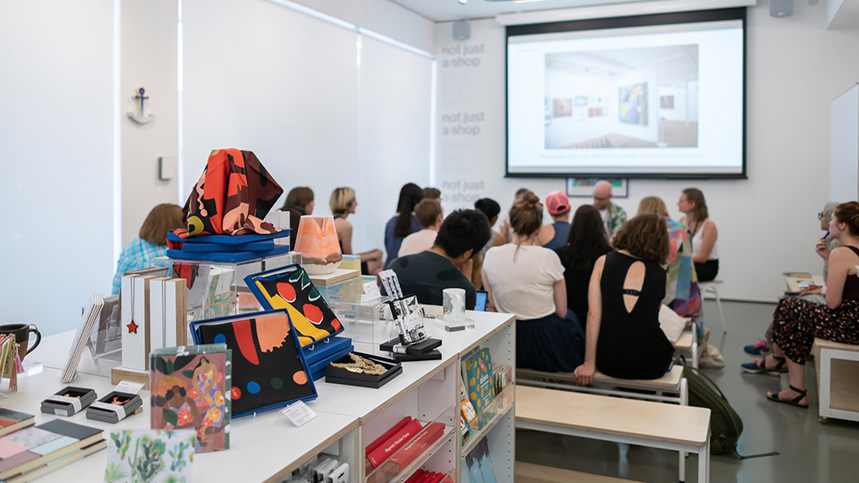 Students attending an event at not just a shop