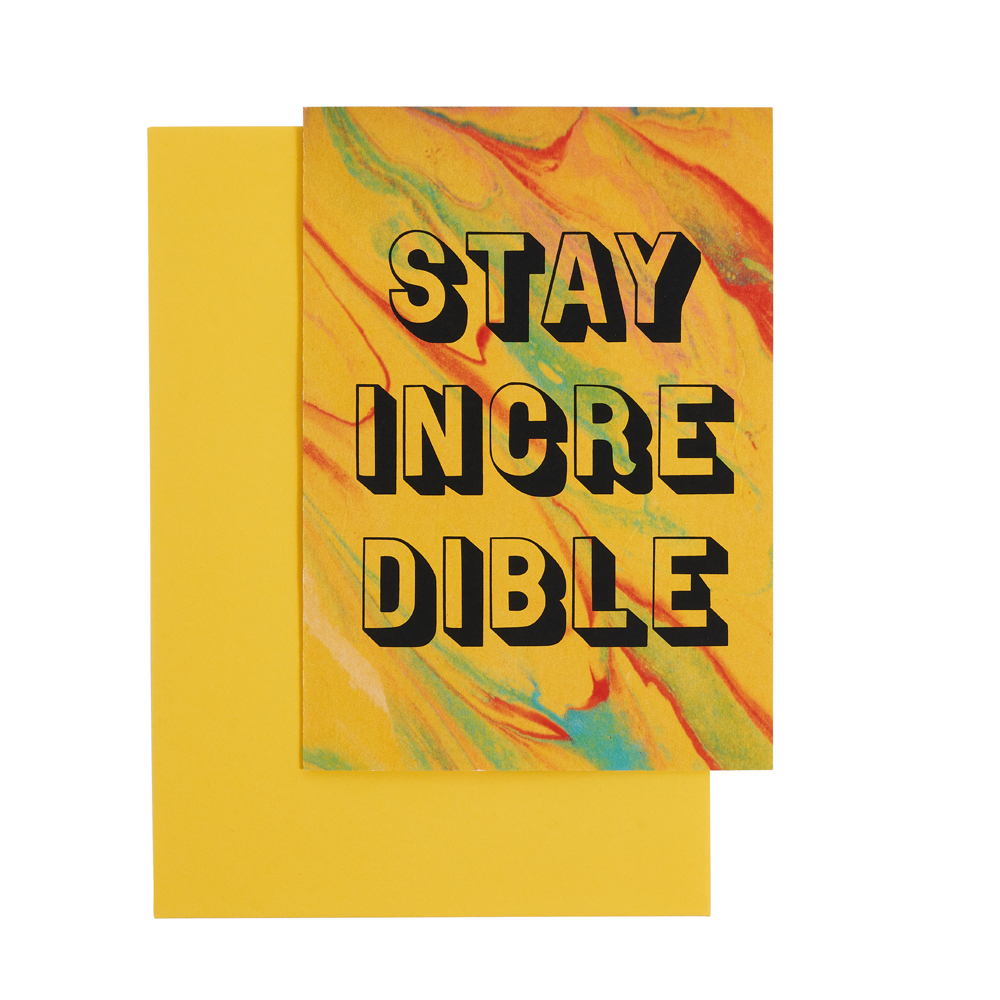 'Stay Incredible' on a yellow marble background with yellow envelope