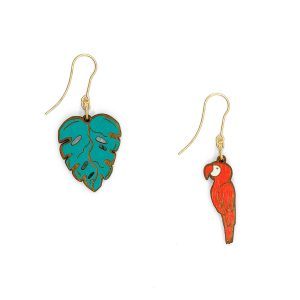 A pair of wood cut drop earrings, one in the shape of a leaf and the other of a red macaw.