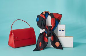 Red handbag and silk scarf
