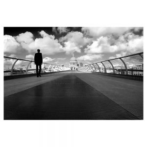 Person standing on Millenium bridge with St Pauls in background