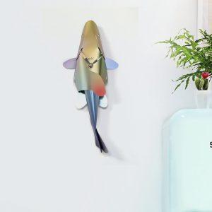 Multi-coloured fish shaped wall clock