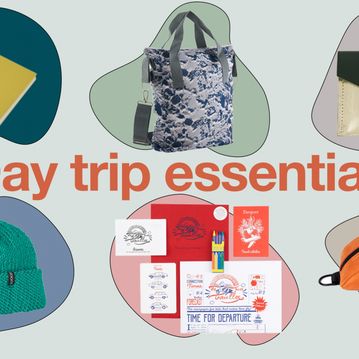 a collection of products selected for day trips, the image features a yellow notebook, a blue tote bag, a green and gold purse, a teal beanie, a children's activity pack, an orange bum bag