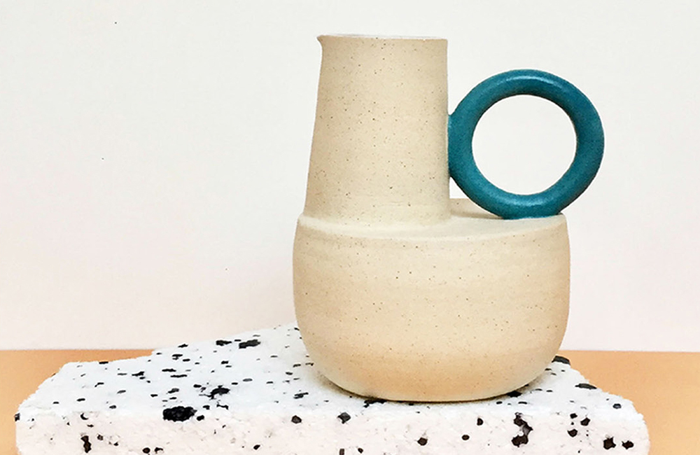 Photo of a jug with a turquoise handle