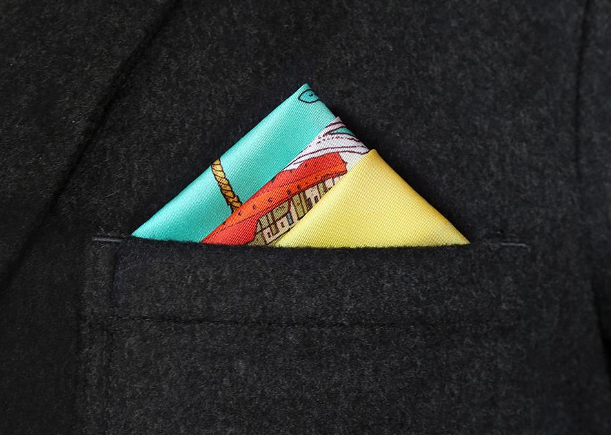 Folded silk pocket square in a pocket