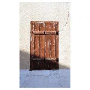 Photo of an old wooden window on a wall