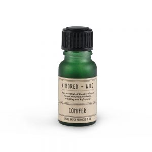 Small green bottle with conifer essential oil
