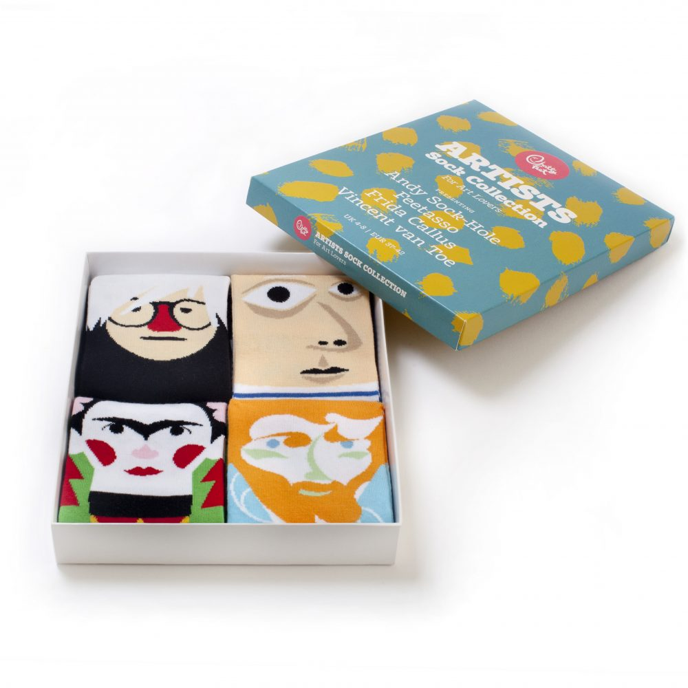 A boxed set of four pairs of socks featuring different artists' faces