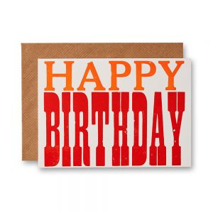 A card with the words 'Happy Birthday' in orange and red type.