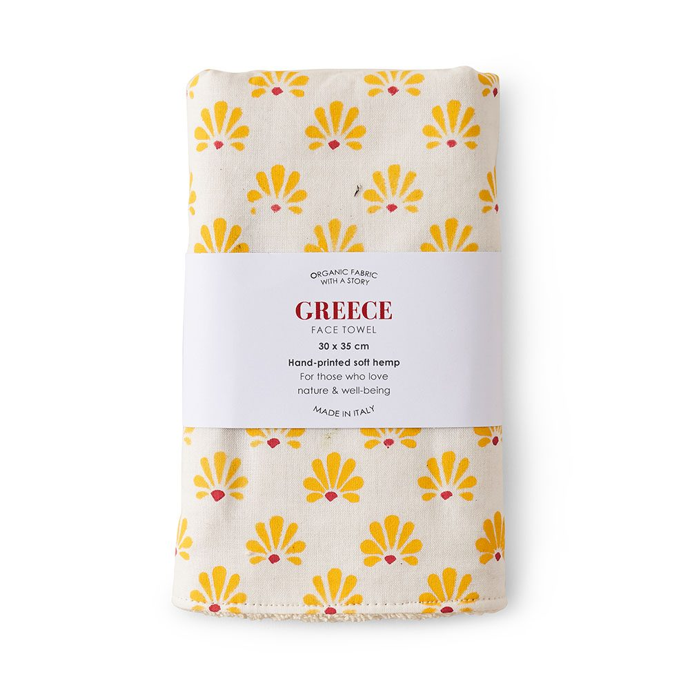 Face towel featuring a yellow print.
