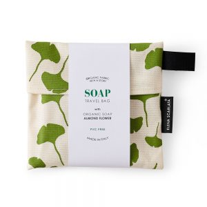 A travel bag with organic soap inside featuring a leaf print.