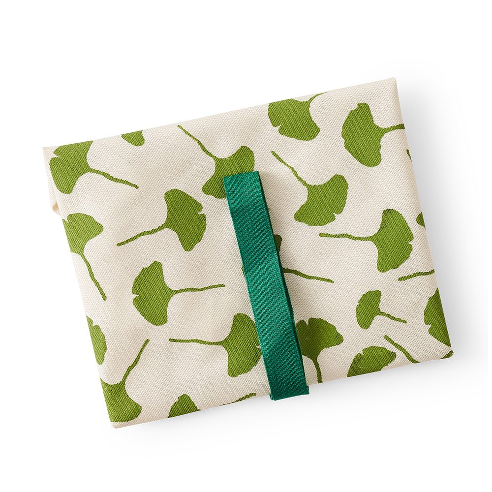 Cotton food wrap with green leaf design.