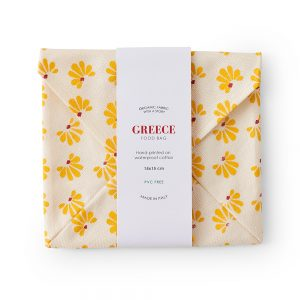 Cotton food wrap with yellow leaf design.
