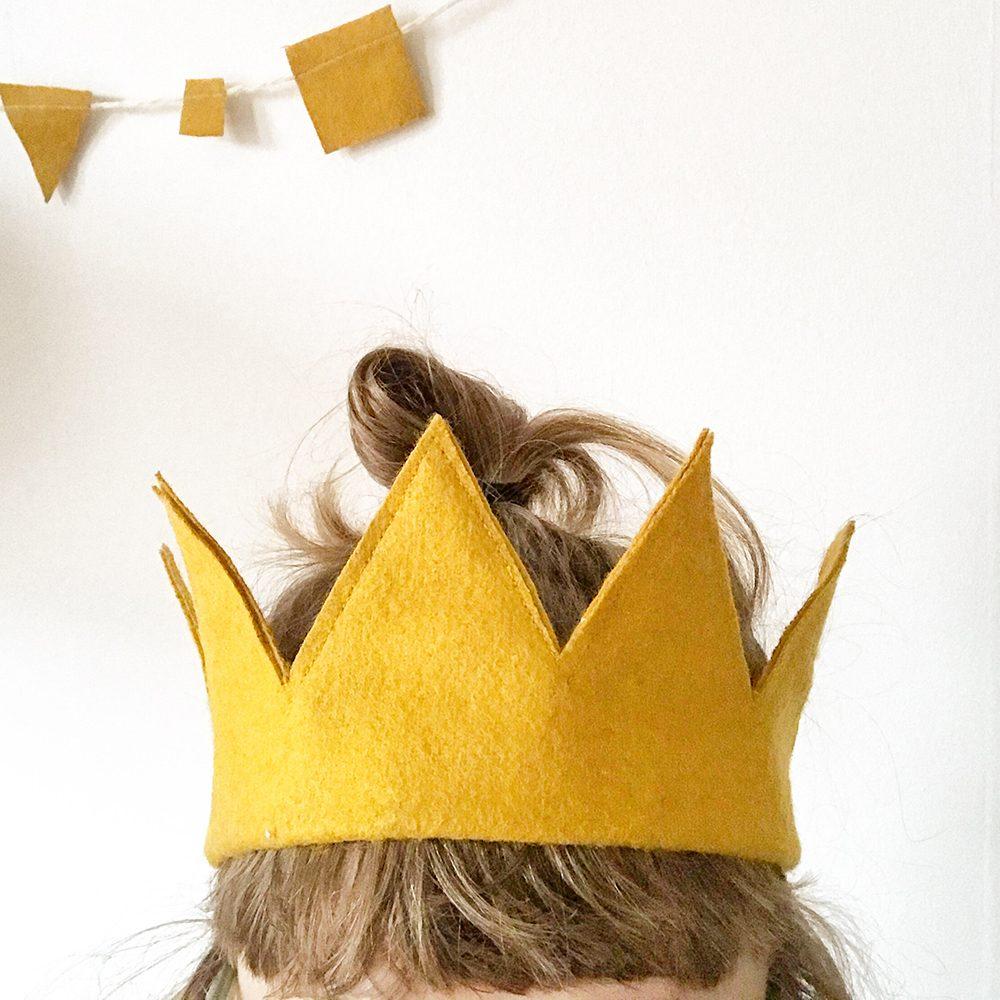 Girl's head with yellow felt crown