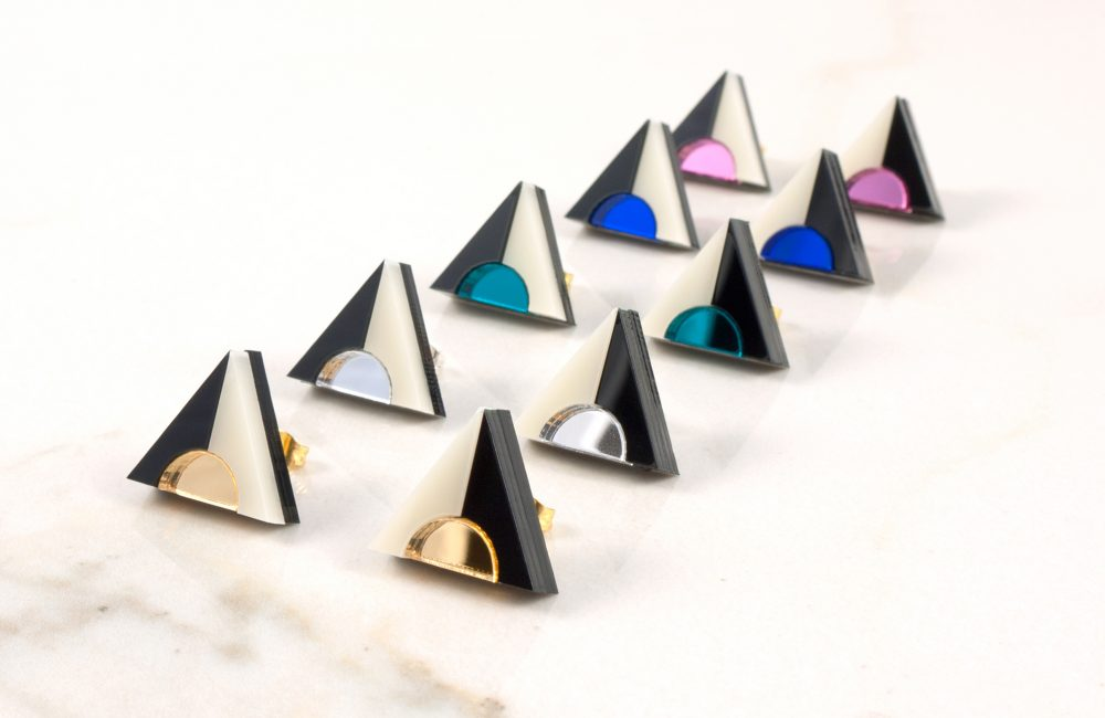 Rows of triangle stud earrings