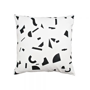 White cushion with black abstract pattern