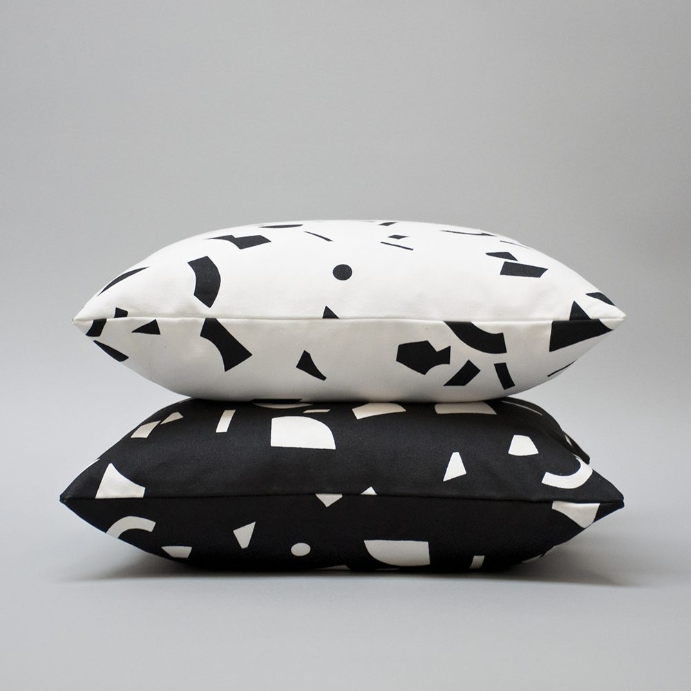 Stack of black and white cushions
