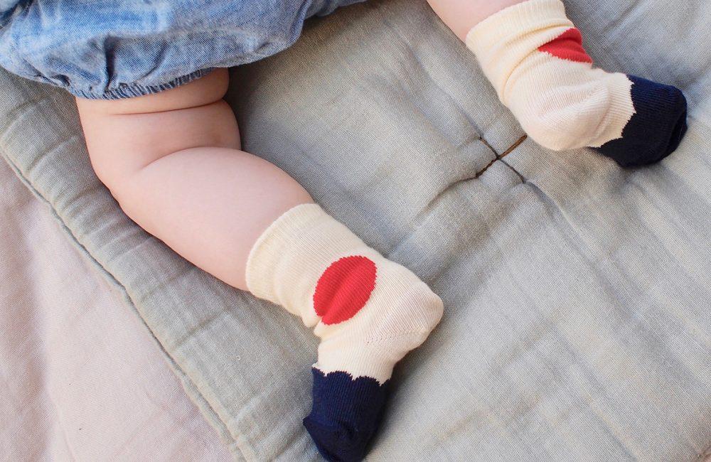 Cream, red and navy baby socks