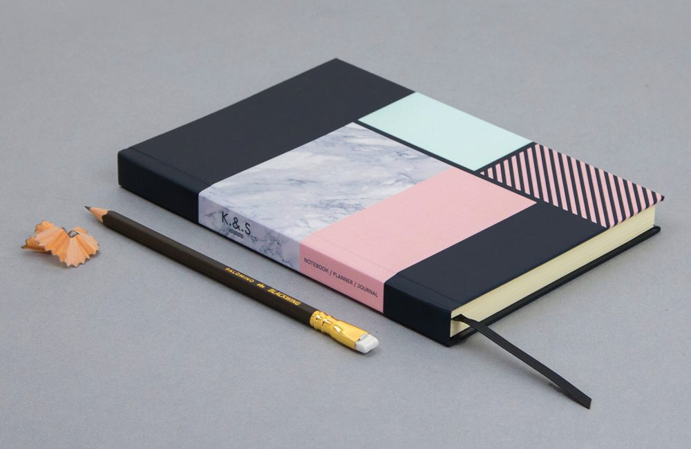 Geometric and marble patterned hardback notebook