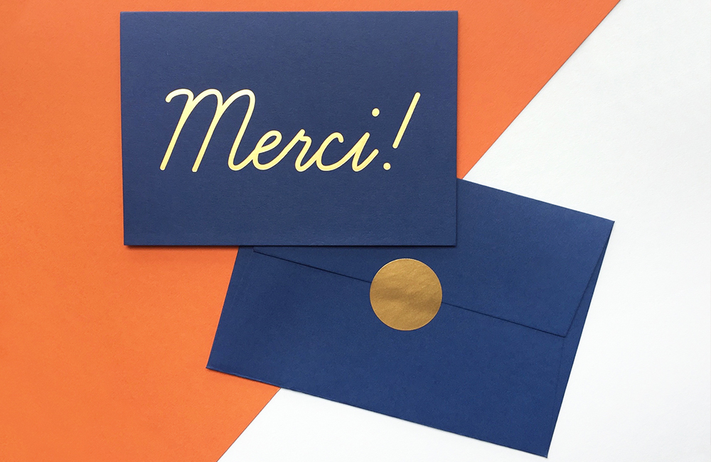 Navy blue thank you card with Merci! in gold foil