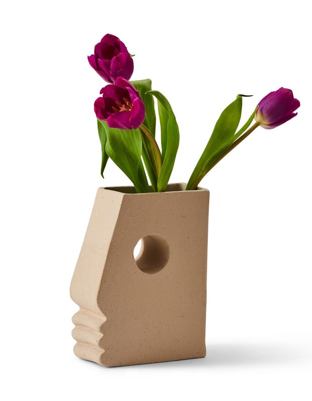 Head shaped vase with tulips in
