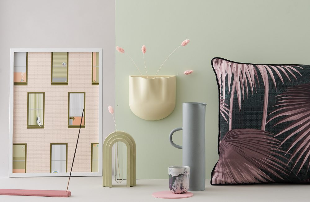 Selection of homeware and decorative products on a light green background.