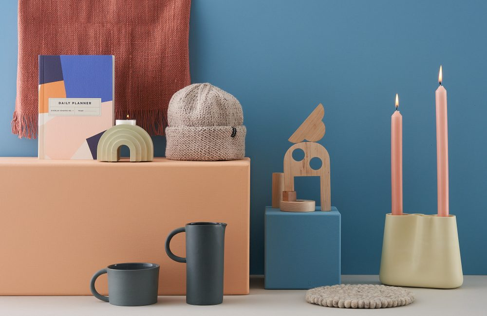 A selection of home decor products against a blue and orange background.