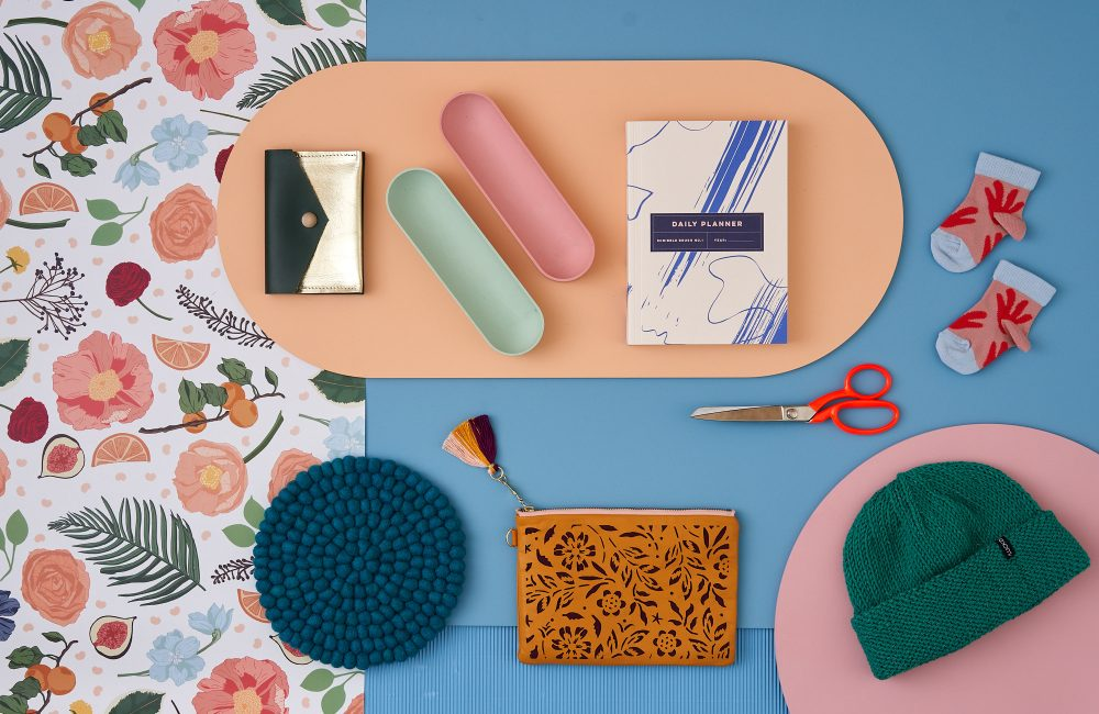 A header image of stationery, desk tidies, and knitted accessories.