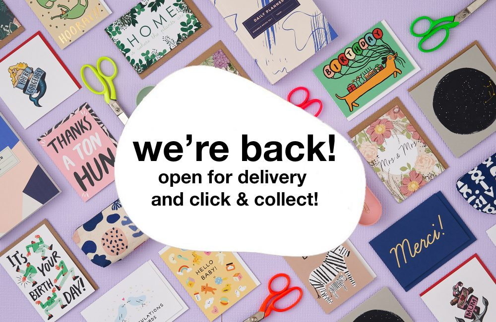 Selection of stationary with a white bubble on top, and the words 'we're back! open for delivery and click & collect'