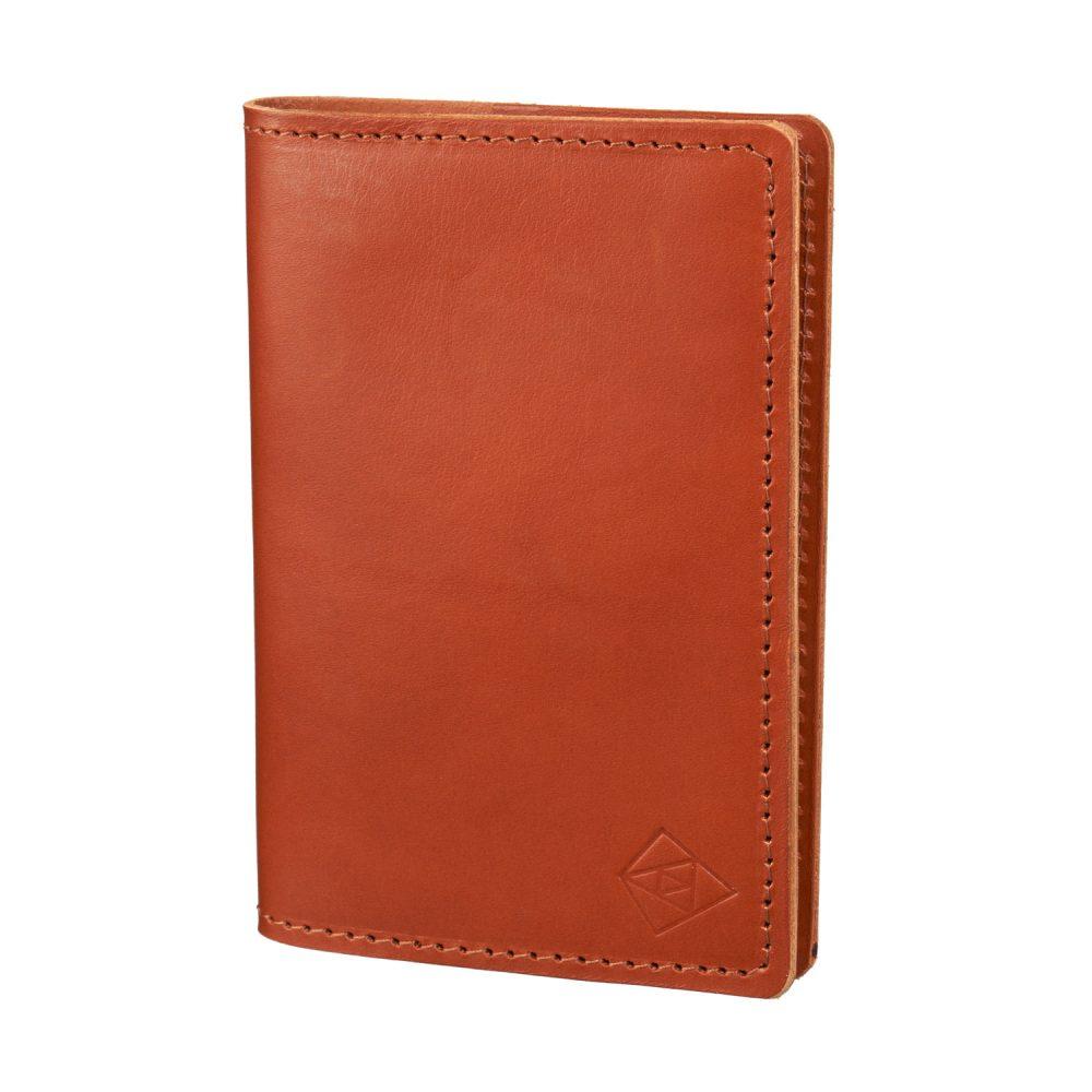 tan passport cover closed