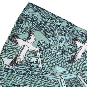 Detail of a silk turquoise pocket square with seagull design
