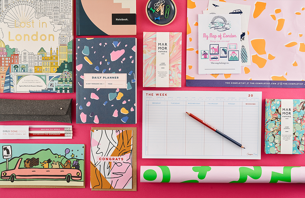 Range of brightly coloured notebooks and stationery