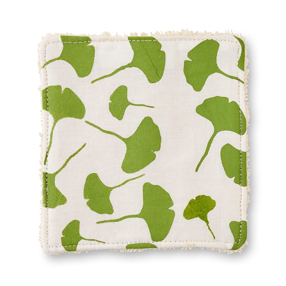 Make up pad with green leaf design.