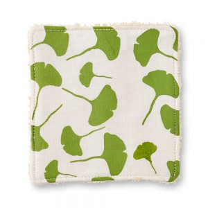 Make up pad with green leaf design.