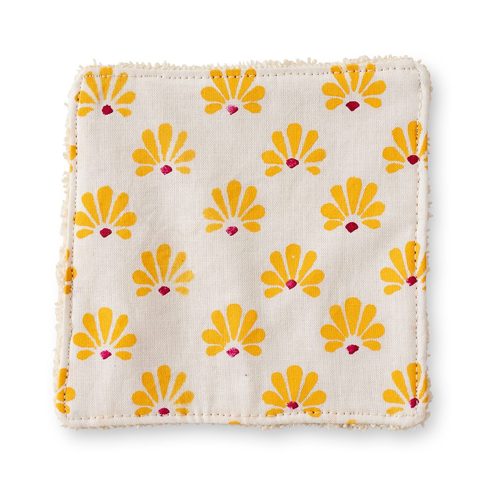 Make up pad with yellow flower design.