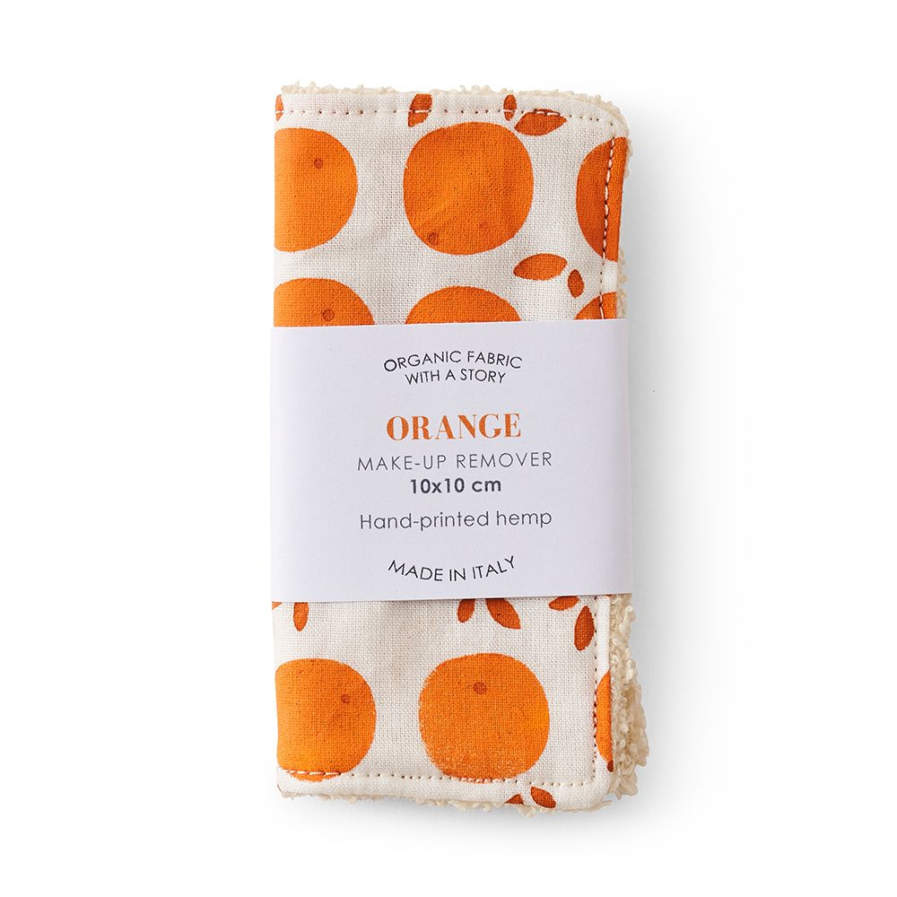 Make up pad with orange fruit design.