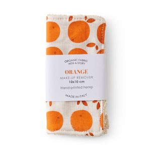 Make up pad with orange fruit design.