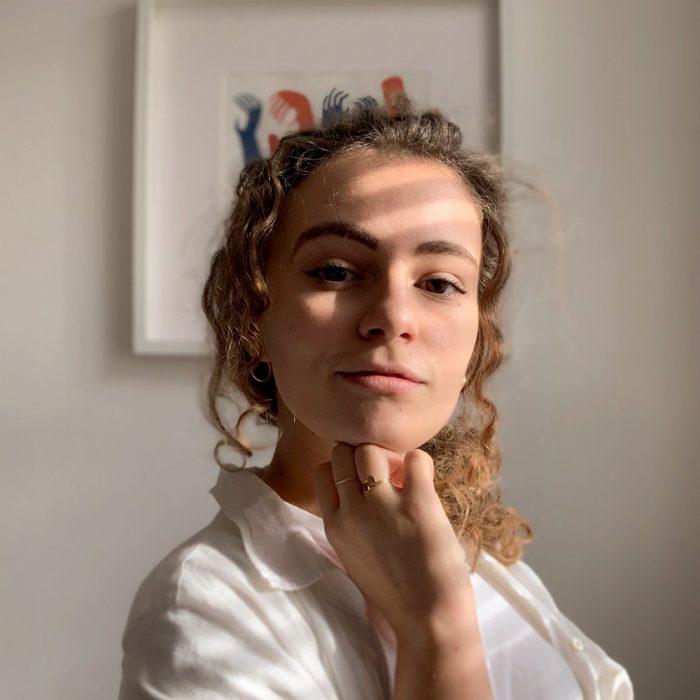 Valeria standing in front of her print